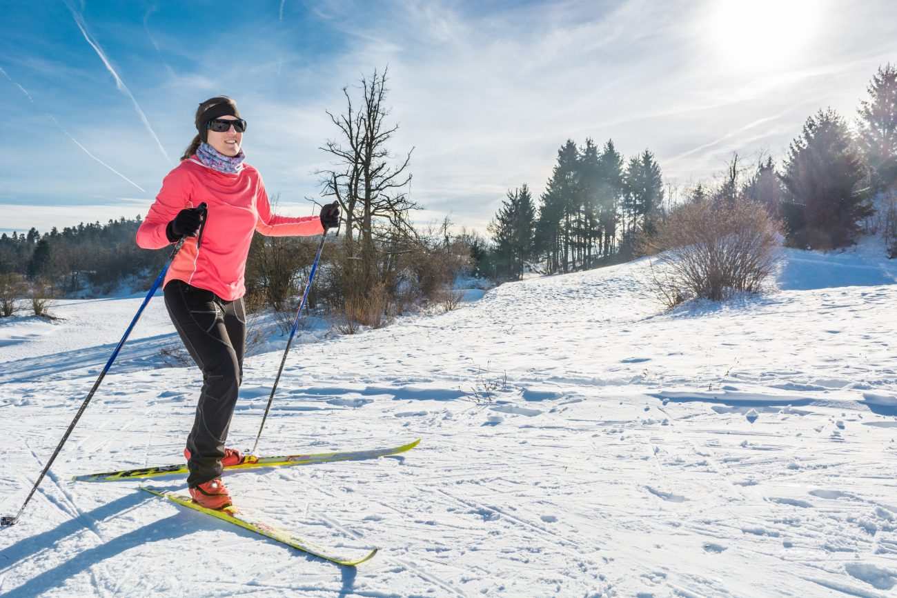 woman cross countrying skiing in bend oregon