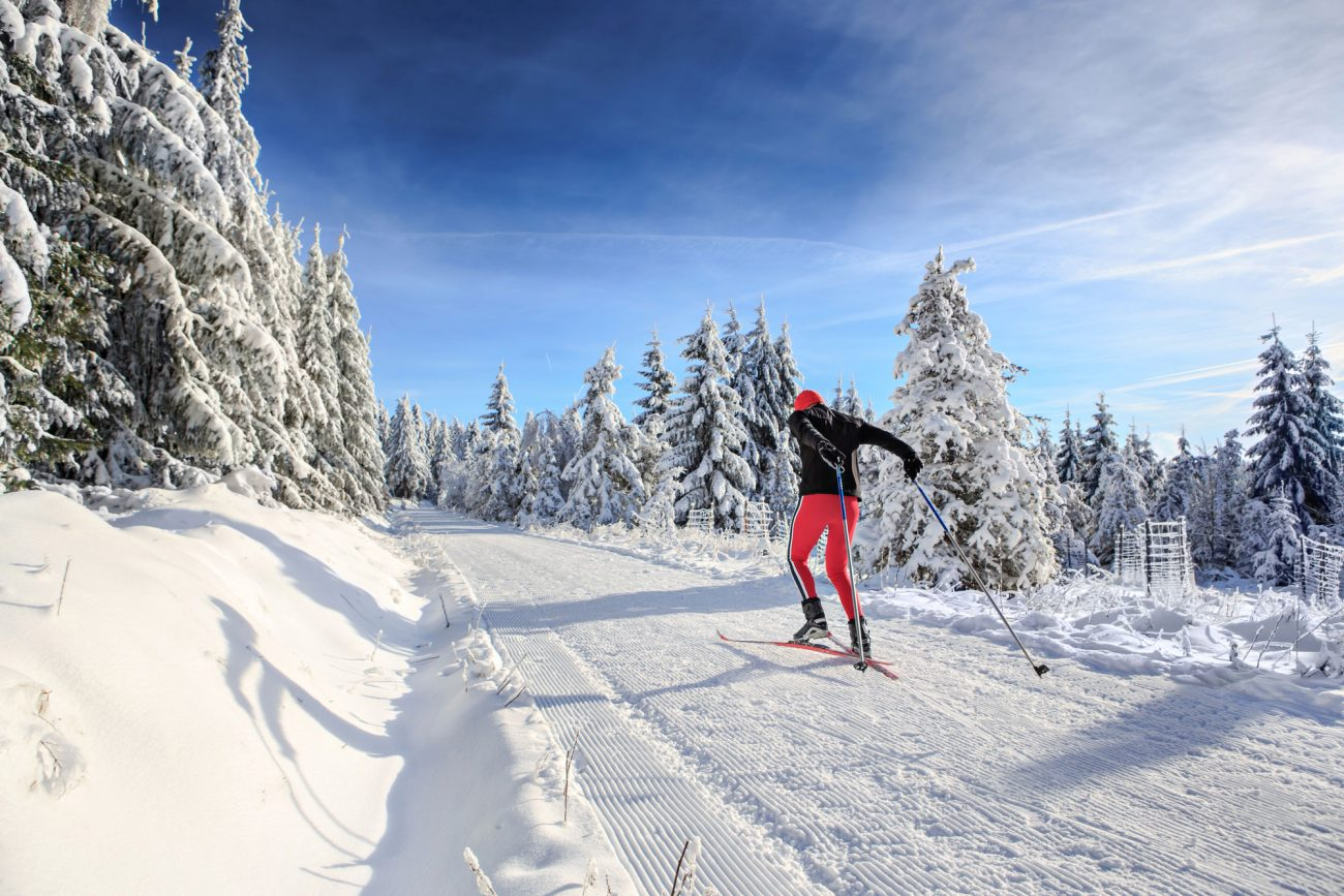man skiing on cross country ski trail in bend oregon